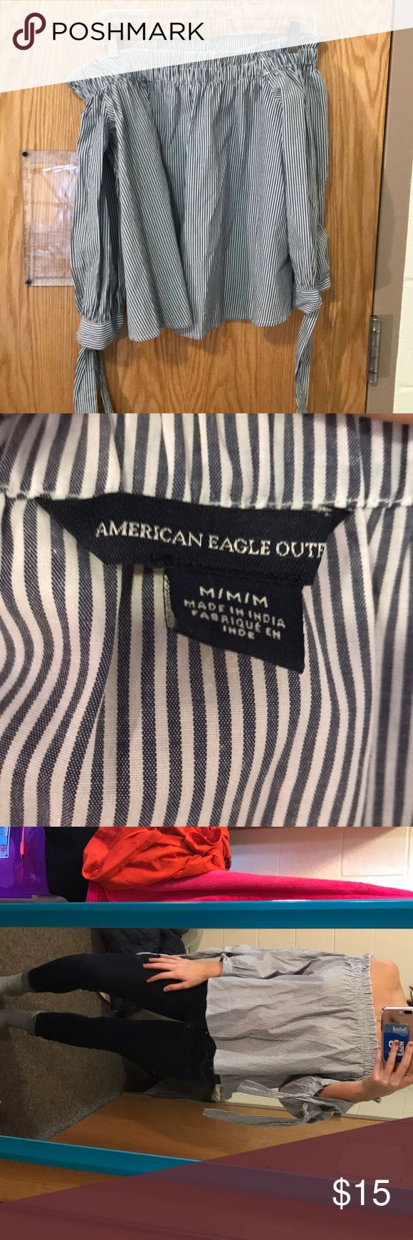 Off the should American eagle shirt Cute off the shoulder shirt. Never worn but no tag. In great shape! American Eagle Outfitters Tops Blouses