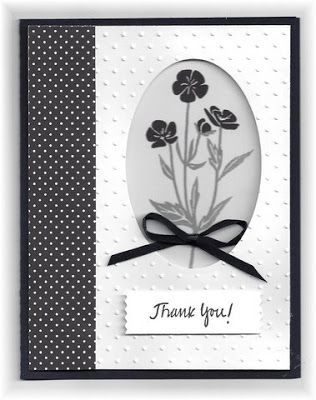 The card - flowers are from SU. I die cut an oval on the white panel. The flowers are stamped on a piece of white that is underneath the cut out. I added a strip of black patterned paper the the le
