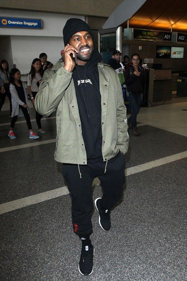Kanye West wearing  Gosha Rubchinskiy x Dover Street Market Sweatpants, Yeezy Season 3 Invitation Jacket, Adidas Ultra Boost Shoes