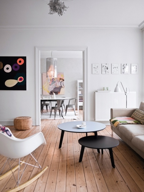 White walls, warm floor, greige sofa. LIke the seamless color transition from living to dining room.