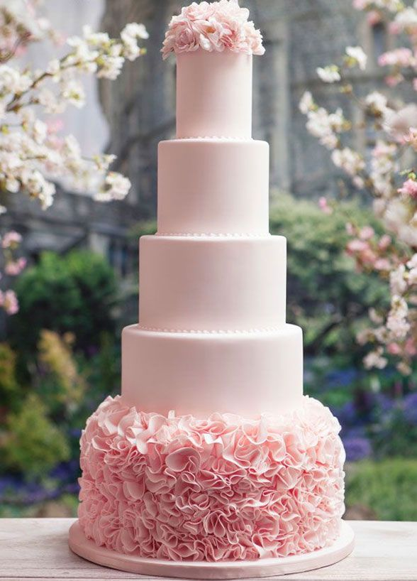 This five tiered pink cake with floral detailing at the base gives romance a whole new meaning.