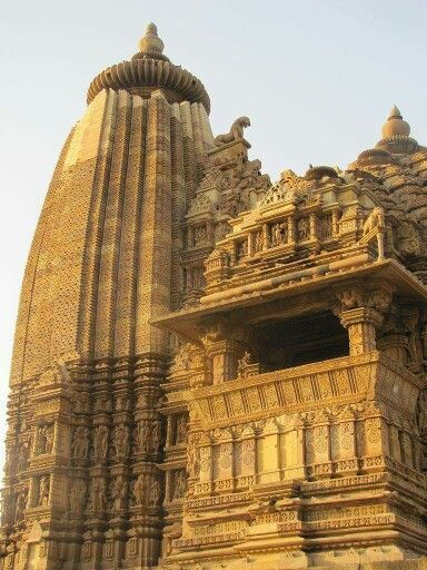 Ancient Vaman Temple at Khajuraho carved with amazing intricacy The temple is the structural one which built by affixing carved stone without using any type of mortar.
