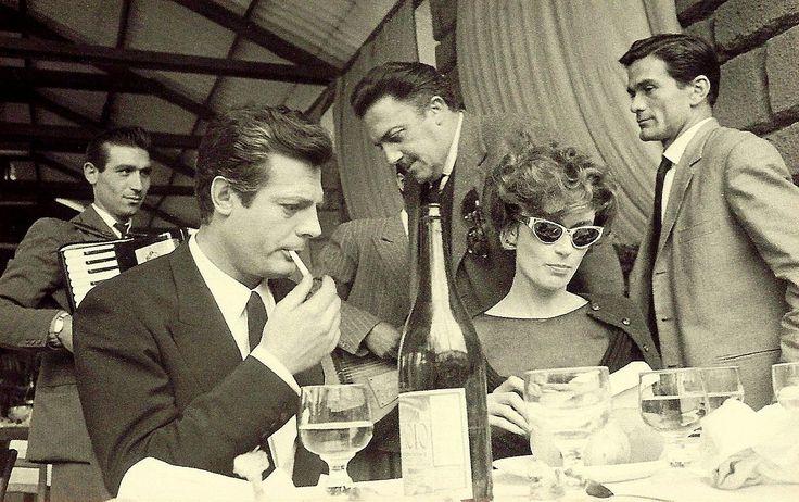 """Federico Fellini, Pier Paolo Pasolini, Marcello Mastroianni and Anouk Aimée on the set of """"La Dolce Vita"""""""