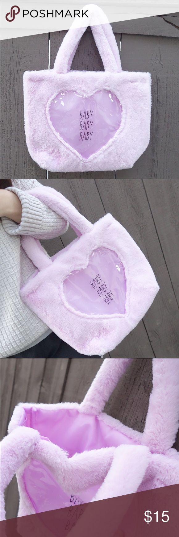 """Baby Purple Plush Kawaii Tote Bag Clear Heart SUPER ADORABLEEEE Kawaii plush baby purple tote bag with a clear heart on one side! Has a divider behind the clear heart to separate the compartments. Measures approximately 13"""" x 10"""". Has a bottom gusset. Brand new with tags. ///Tags: Japan Brandy Melville Lolita princess urban forever 21 Bags Totes"""