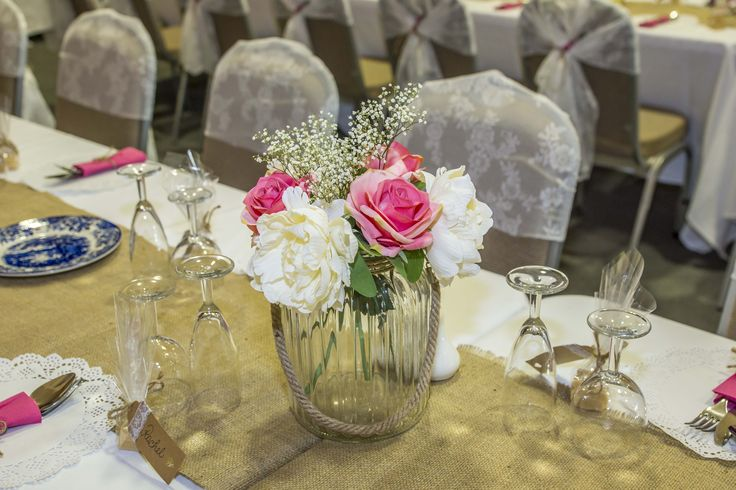 A lovely real flower centrepiece. Colour matching to the bride's own bouquet.