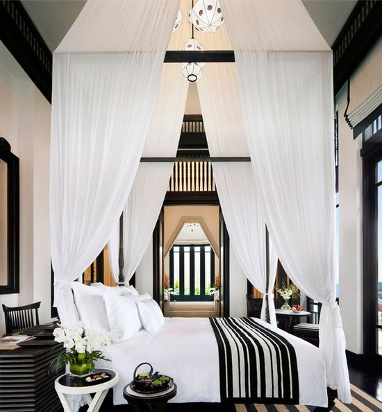 Here is a beautiful bedroom that could be in a house in the Hamptons or somewhere in a tropical getaway.  In this image I was attracted to the linear elements of the bedding, side table, chair, rug and windows in the background.  Repeating an element such as stripes helps to unite a space and keep it from being boring.