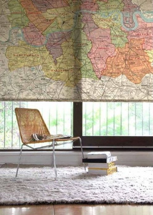 Great window covering idea. Old classroom pull-down map. Or use on an interior wall to cover a TV