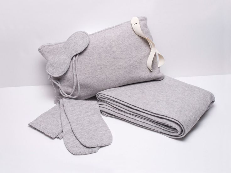Le Kaska cashmere travel set: a blanket/shawl, sleep mask, and long socks, with a pouch that doubles as a pillow.