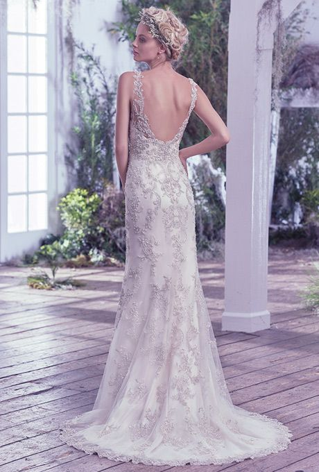 Brides: Maggie Sottero. Greer. See More Details from Maggie SotteroBead embellished sheath wedding dress features Swarovski crystals. Illusion straps and plunging V-neckline, finished with stunning scoop back and zipper closure.