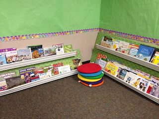 brilliant idea for classroom library display ~ rain gutters mounted to fabric-covered plywood ~ so clever!