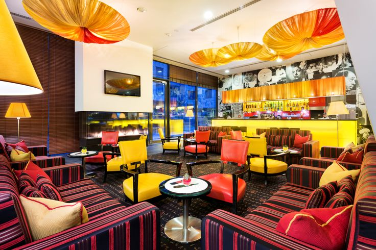 Enjoy #modern living in Prague's #entertainment district in the angelo by Vienna House Prague. #colourful #interiordesign #red #yellow #boldcolours #hotellife