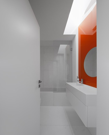 All White Top Lit Bathroom With Bright Orange Accent The House In Lisbon