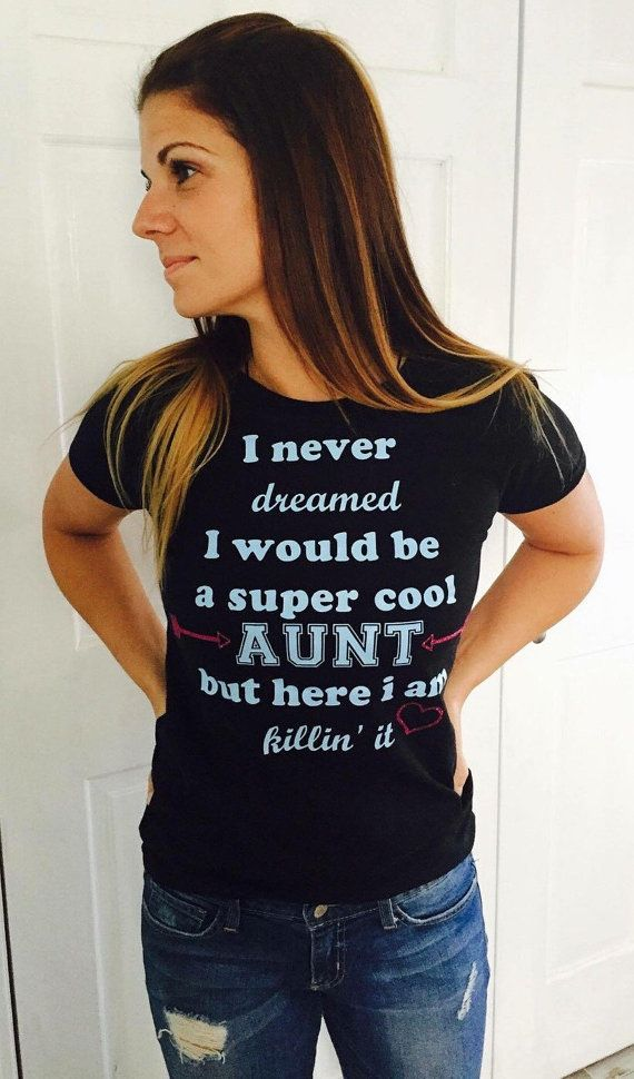 I never dreamed i would be a super cool aunt but here i am killing it t-shirt    Comes in a unisex t-shirt     Pick your size and t-shirt color!  *include in comments when you order the color you would like the writing- standard is white with silver glitter arrows and a heart (on black shirt) Black with gold arrows and heart on white)  ***if no colors are specified you will get standard colors    ***I CAN DO OTHER SHIRT COLORS! just message me!!!! | Shop this product here: spree.to/54a…