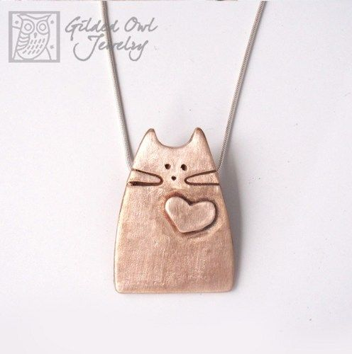 A new addition to my cat family! A Bronze Cat Pendant with a little heart. Totally adoptable!  ***IMPORTANT NOTE:  The price is $62 with the Adjustable Black, Leather Cord and if you'd like the Sterli