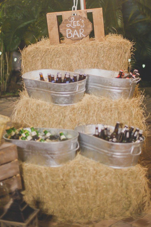 Bride to Be Reading ~ Simple Rustic Wedding Idea - serve drinks from tin tubs or maybe wicker baskets. Hay bales of course!