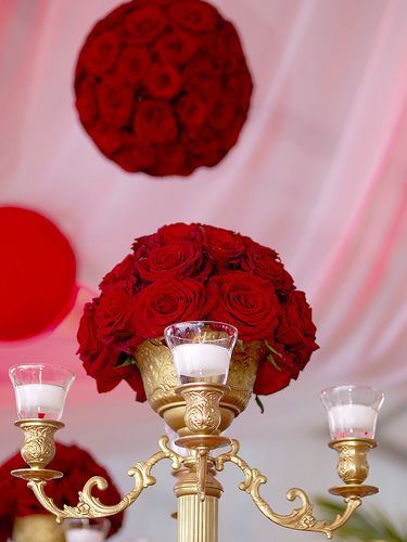 Red rose centerpieces pomanders and quot net ceiling for