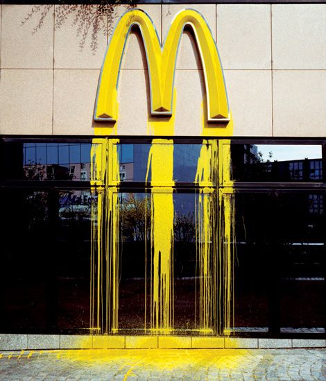 """ZEVS, the French street artist whose street art and graffiti """"distorts the logos"""" of corporate brands"""
