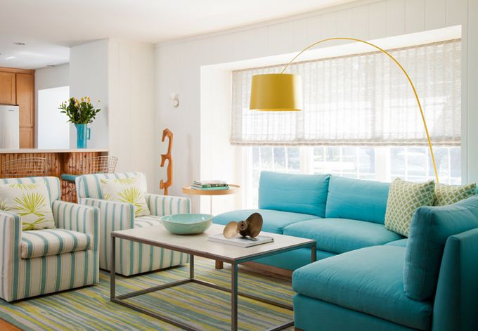 House of Turquoise: Turquoise Sofas Great way of dealing with front door opening into living space.