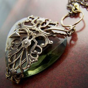 Cupids arrow pierces this beautiful antique Czechoslovakian heart shaped black diamond jewel corseted in Art Nouveau filigree.