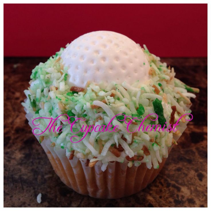 """golfball cupcakes: green coconut """"grass"""" and white chocolate golfball topper"""