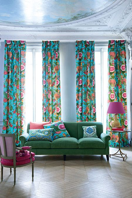By Manuel Canovas. Co-ordinating curtains and scatter cushions to make high ceiling rooms look cosier.