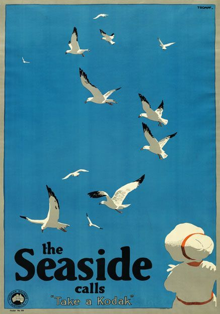 Travel poster produced c1935 by Victorian Railways to help encourage visitors to Melbourne. A young lady fashionably clothed in a white summer dress and matching bonnet sits with her back to us looking out upon a clear blue sky admiring the seagulls. Definitely time to 'Take a Kodak'. The artist Percy Trompf (1902-1964) was born in Victoria, Australia and began his commercial artistic career designing confectionery packaging. He also designed thousands of advertising posters but the…