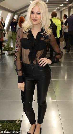 Racy! Going braless under a risqué sheer shirt, the top featured bra shaped…