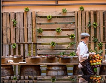 IDEA: Palette Wall Backdrop behind the Seafood and Arancinci station - we can fill it with fresh herbs and hanging vines
