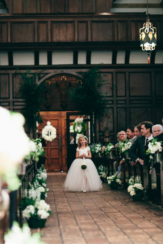 Flower girl wears a halo of baby's breath and carries a mossed pomander ball down the aisle.