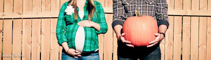 37 week fall maternity photos with pumpkin; maternity photos with husband holding pumpkin