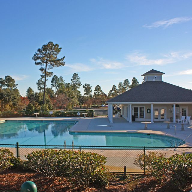 The outdoor pool at Magnolia Greens in Leland, NC. #LelandNC #Communities #RealEstate #RealEstate #Realtor #Realty #Broker #ForSale #HouseHunting #HomesForSale #Property #Properties #Home #Listing #JustListed #FreshListing #RHomePosse #LoveWhereYouLive #P