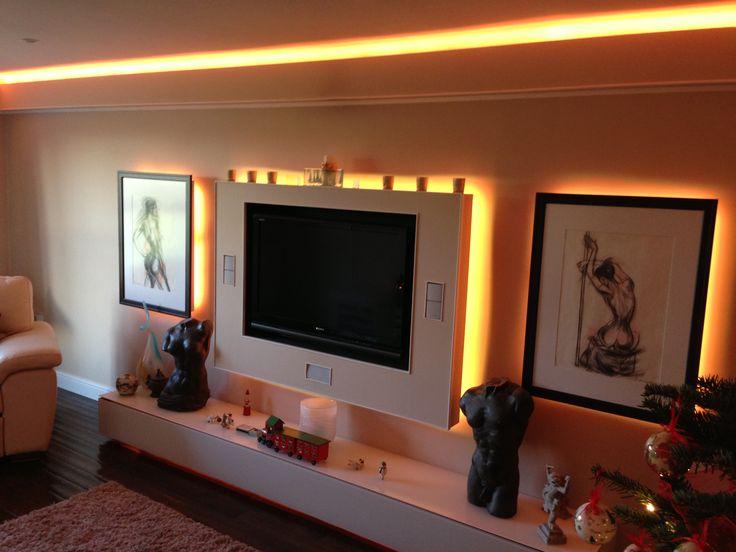 Consider LED tape soffit lighting in living room.