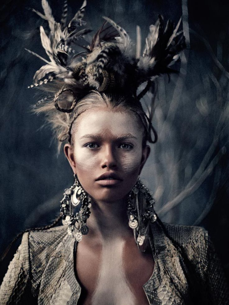 """Love the feel of this photo - but just a little too much """"embellishment"""" for Lost Apostle - Great colour in background, great lighting, - no to the makeup though! - I'd love some feathers in the hair, cool bowler hat..."""
