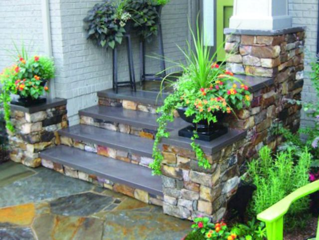 Porch Makeover - an upgrade from basic concrete to flagstone with bluestone step treads; colorful planters complete the look #Cary