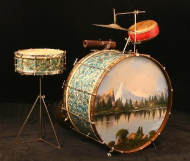 "...gorgeous old kit from 1929, made by Ludwig and Ludwig. Fabulous drum head painting (that's quite a peak in the distance: like Mt. Fuji on steroids) and what a beautiful finish: it's called ""Peacock Pearl""."