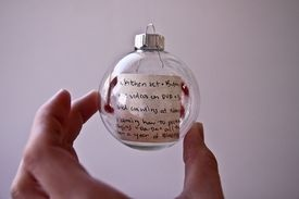 Put the kids christmas letter to santa in a glass orament  and place on tree each year.