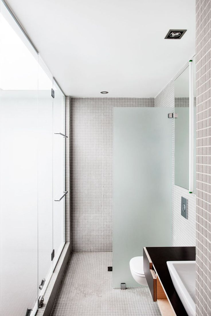 Bathroom Tile Idea - Use The Same Tile On The Floors And The Walls   Grey tiles used on the floors and walls of this bathroom create a neutral and relaxing space.