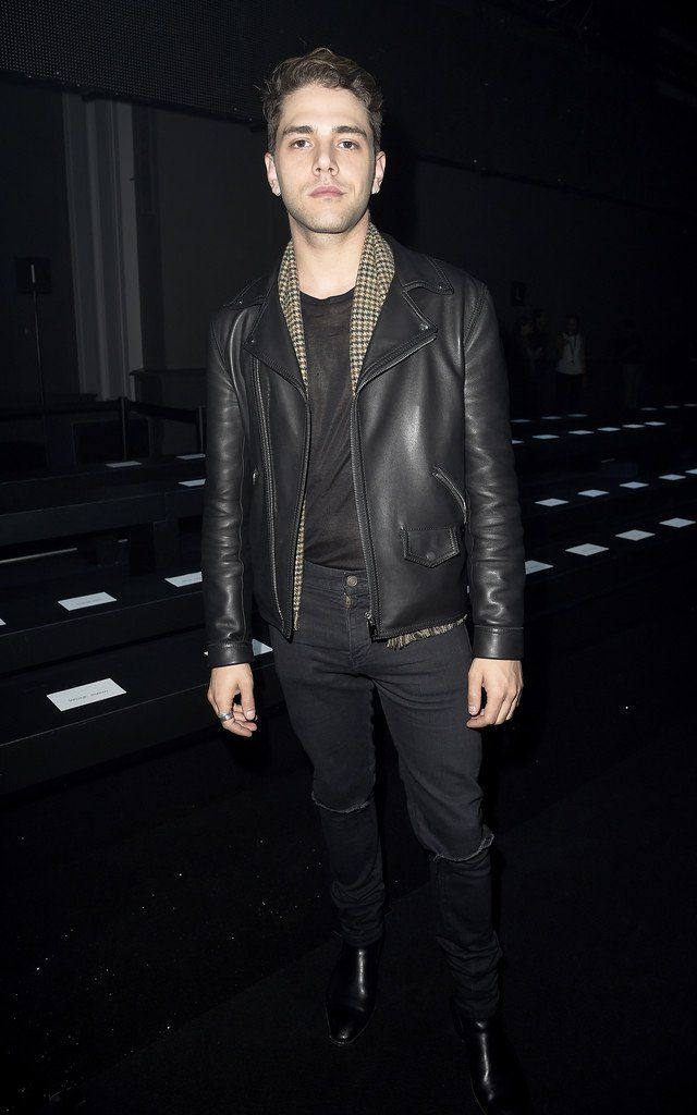 Attending Chanel's spring 2015 womenswear show, Xavier Dolan went for a simple dark look, elevated with a retro-inspired black and white print shirt. A fro