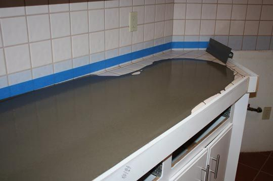 Concrete counter tops poured on top of existing tile tops. Wow!