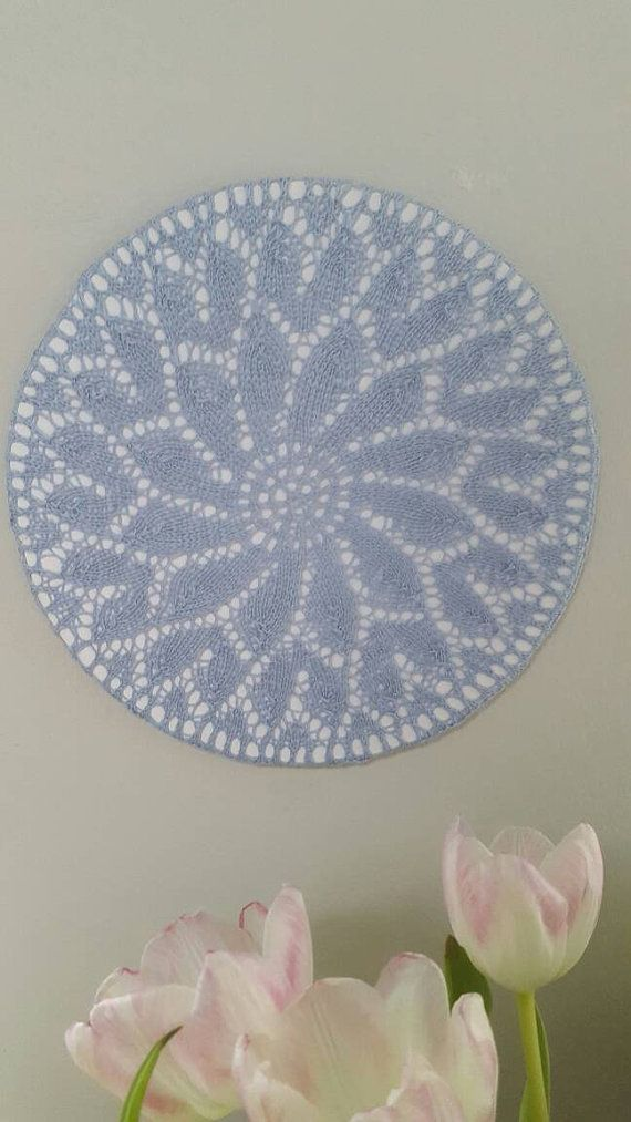 Check out this item in my Etsy shop https://www.etsy.com/dk-en/listing/271579197/handknit-doily-made-in-to-a-wall-hanging