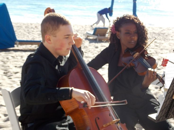 Violin and cello duo performing at a sunrise beach ceremony on Valentine's Day (Wyndham Deerfield Beach Resort)