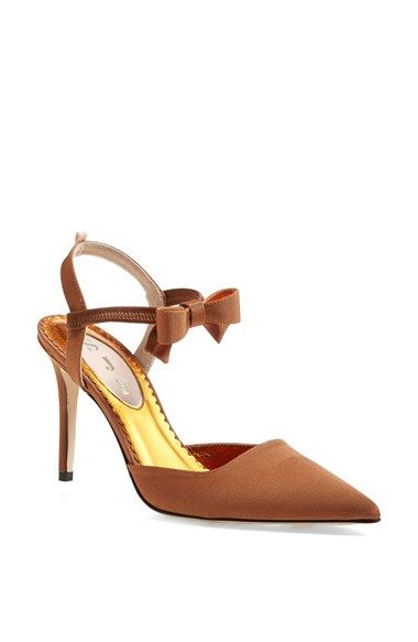 Sarah Jessica Parker SJP 'Pola' Pointy Toe Pump (Nordstrom Exclusive) at Nordstrom.com. cut daringly low—heightens the ultrafemme impact of a sleek satin pump with a bow-trimmed ankle strap and a pretty pointed toe. A bit of delicate grosgrain ribbon trim pays tribute to designer Sarah Jessica Parker's favorite childhood adornment while providing a signature finishing touch.