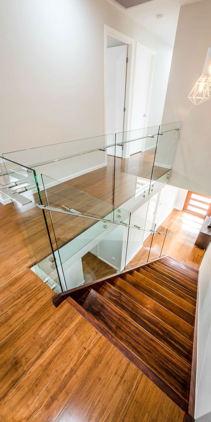 Glass balustrade with stainless steel mirror polished handrails and fittings