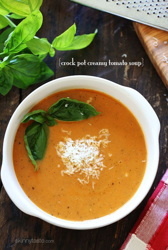 This creamy, rich tasting tomato soup is made in the slow cooker, with tomatoes, herbs, milk and Pecorino Romano cheese, plus the cheese rind for an added flavor boost.   Last night for dinner, we had a big bowl of this soup with some grilled garlic bread and a simple garden salad. For lunch, I usually like to have a small cup with a half sandwich (whole wheat grilled cheese – yum!).     Thanks to my parents, I'm real picky when it comes to soup. I grew up in home where we had homemade soup…