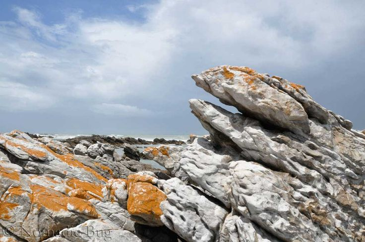 The Cape of needles, rocky seas, Cape Agulhas, South Africa Landmarks Nomadic Existence