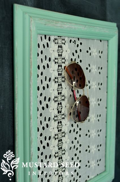 DIY Paint an old picture frame, staple some eyelet lace onto the back, and you have a vintage look sunglasses or earring holder.  by Miss Mustard Seed.