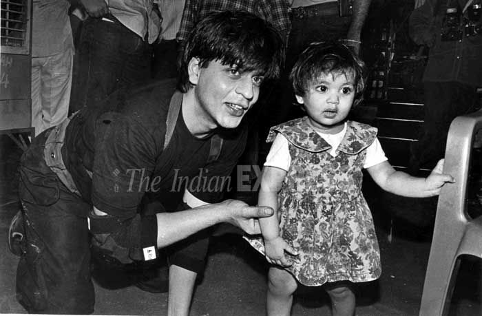 Shahrukh Khan - 'Awww – Suhana and Shah Rukh spend some father-daughter time on the film sets. Suhana is now 13 years old'. (Express archive photo) Credit: The Indian Express online (2013)
