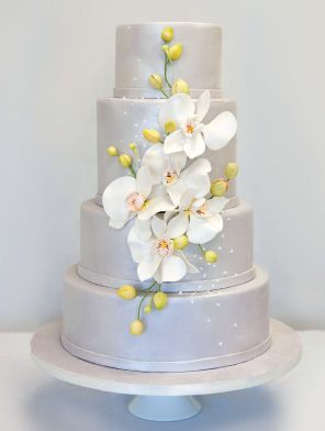 Cascading Orchids  This modern silver cake is decorated with a cascade of white sugar orchids and is perfect for a spring wedding.  Vanilla bean cake torted and filled with raspberry and lemon curd would be a perfect pairing.