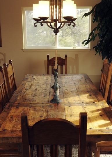 Rustic dining table. Chairs might look better repainted though...