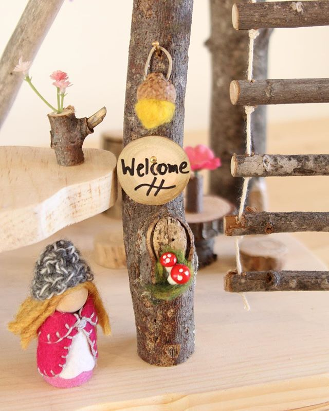 Welcome! #woodentreehouseplayset #treehouse #welcomesign #fairy #lantern #acorn #ropeladder #woodentoys #handmade #makersofygk #madeincanada #flowerpot #toadstool #ygk #cityofkingston #woodpeckerforest